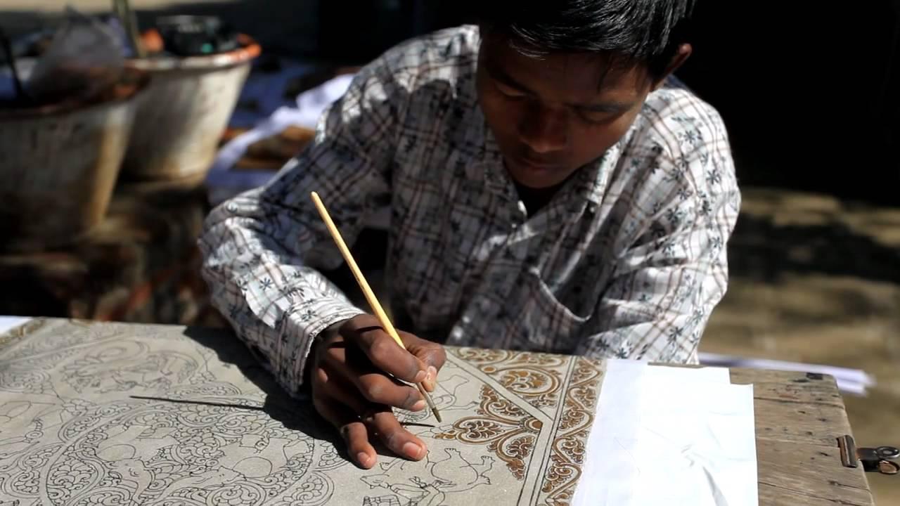 Sand painting artist